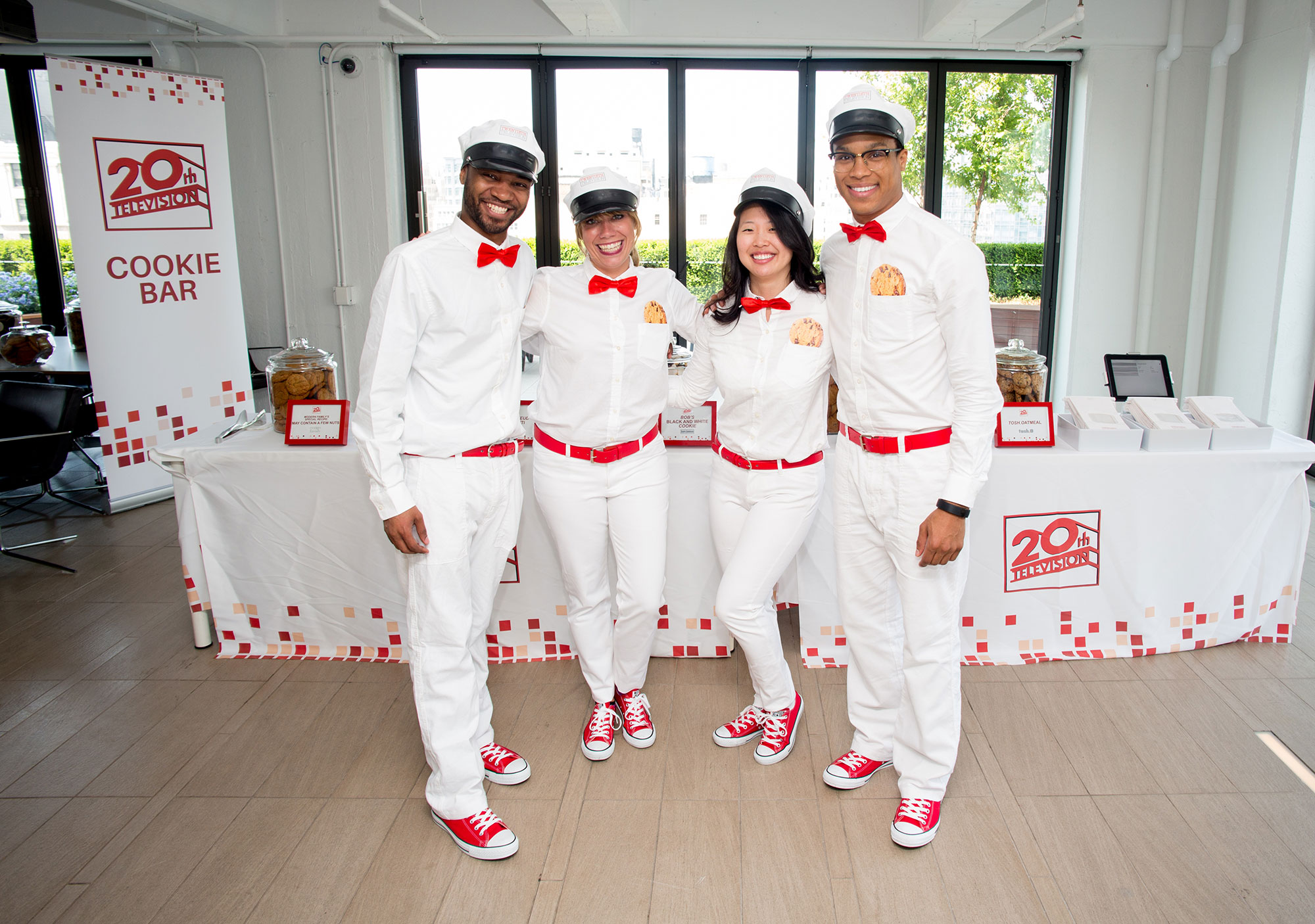 "Brand Ambassadors dressed as modern ""milk men"" while serving milk and cookie shots and assisting employees with filling their cookie bags."