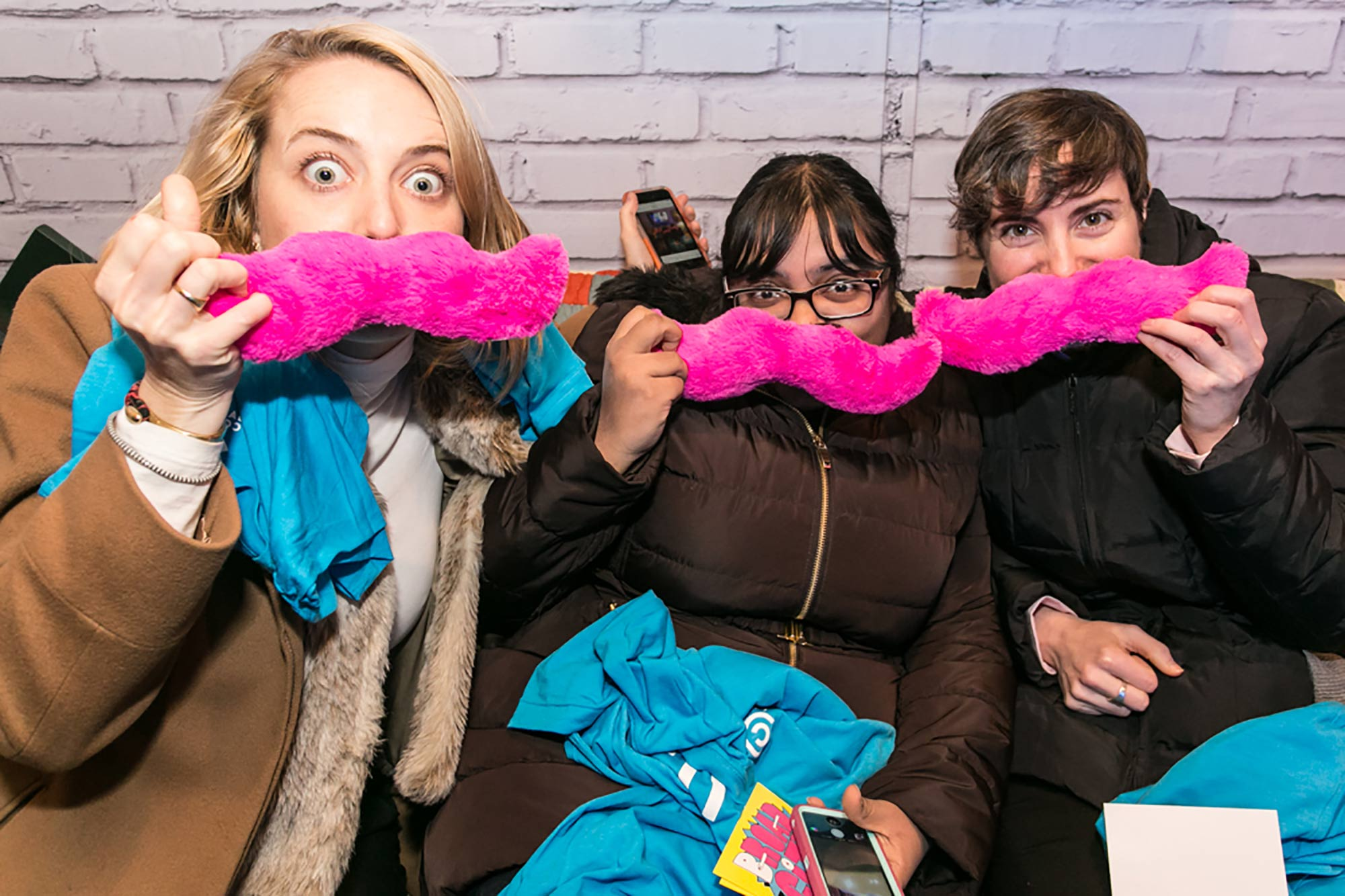 Lyft's fuzzy pink mustaches made for perfect photo props on board Comedy Central's Broad City RV.
