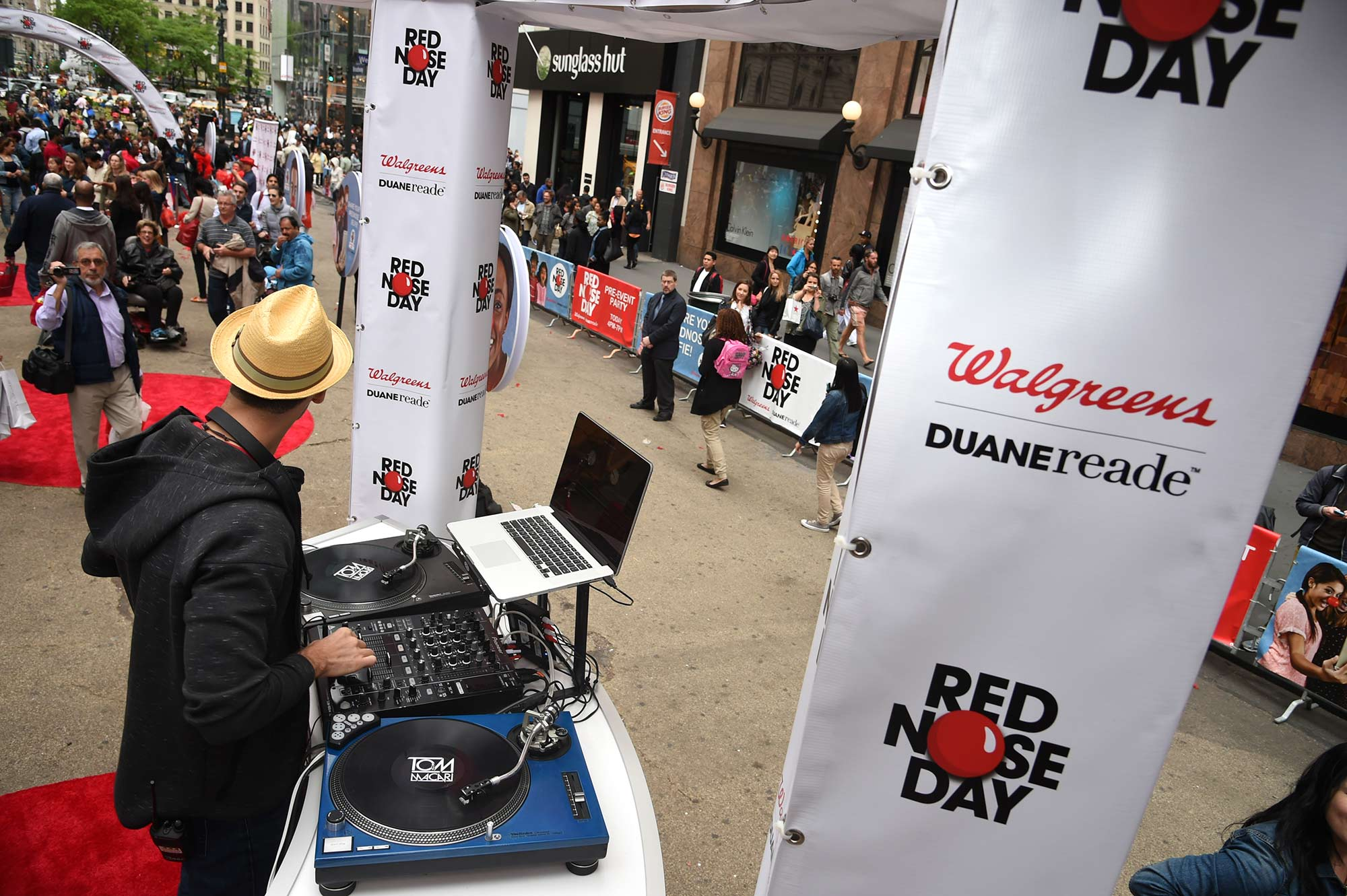 The DJ at Duane Reade's Red Nose Day Pre-Event Party prepares to spin away as guests arrive.