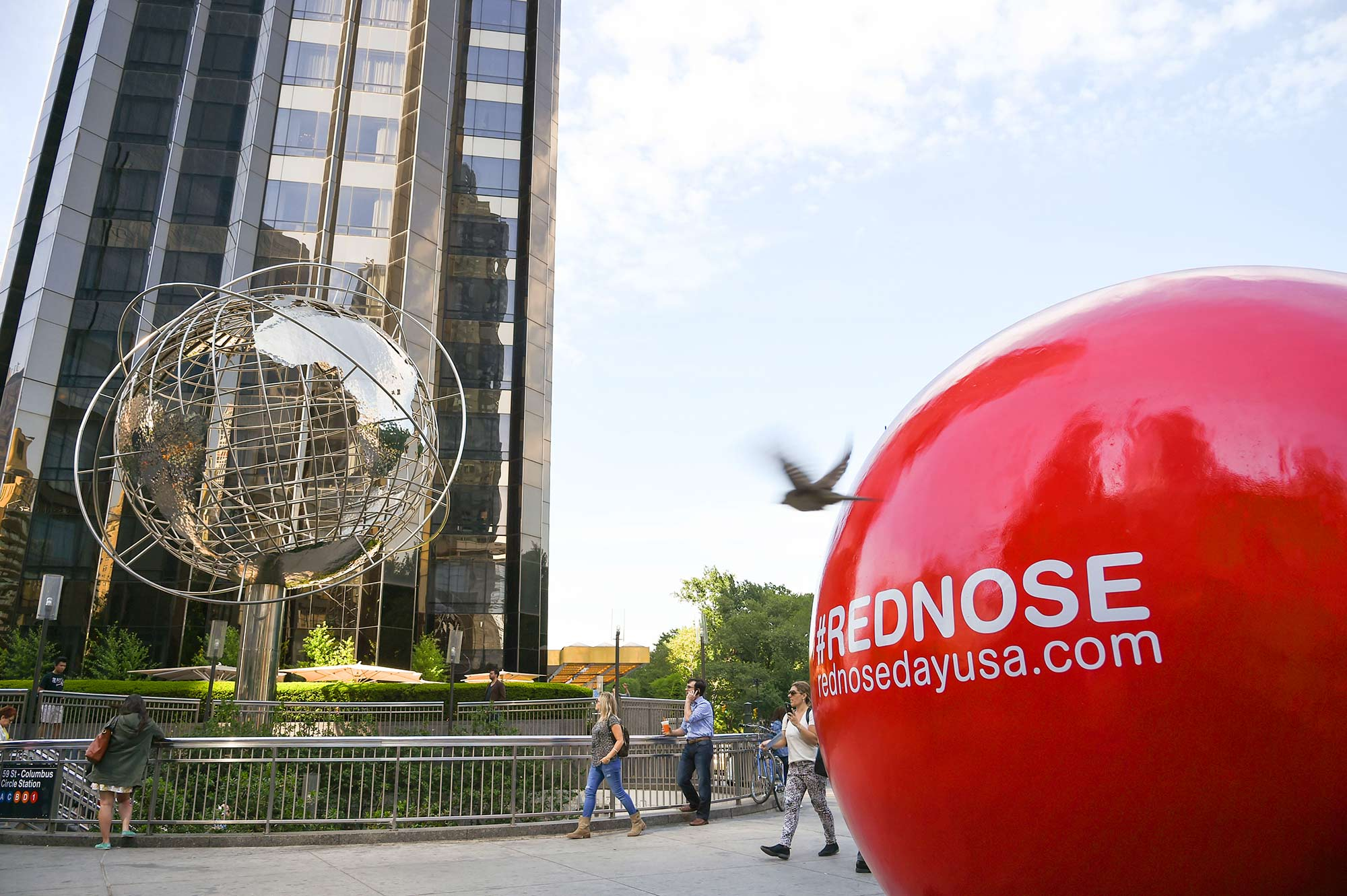 One of 5 larger-than-life Red Nose statues sits proudly in New York City's Columbus Circle.