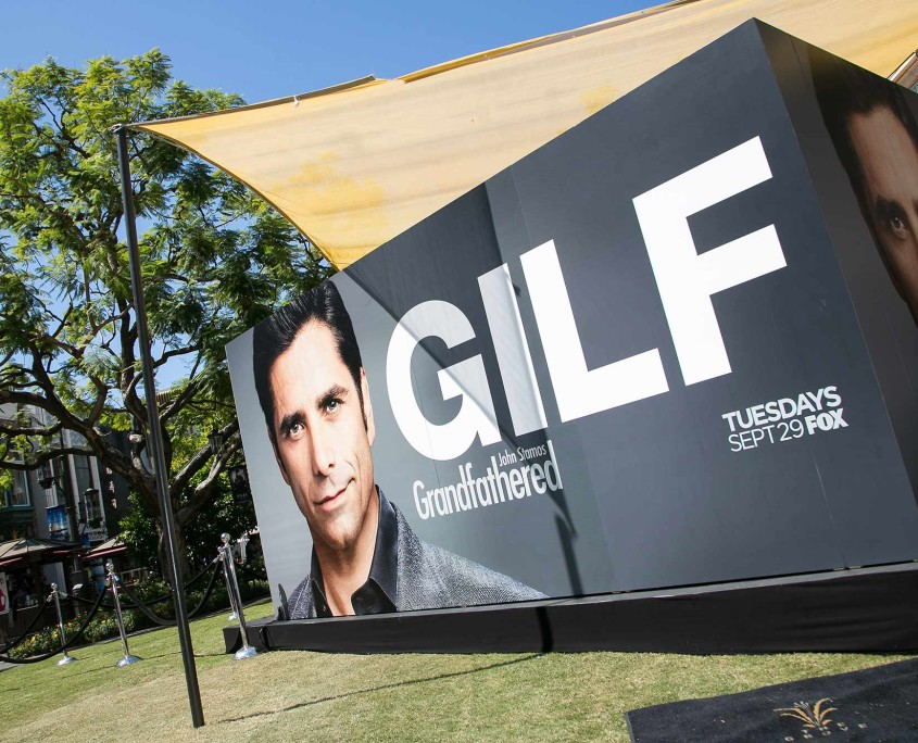 The GILF, John Stamos, was unmistakeable on this huge promotional wrap for FOX at the Grandfathered Pop-Up Barbershop.