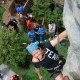 A participant climbs the rock wall at History Channel's Mountain Men City Trek in New York City's Union Square.