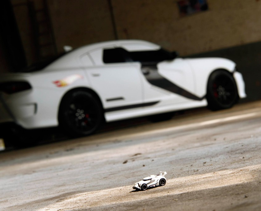 The Hot Wheels Stormtrooper toy car looks tiny compared to the Dodge SRT wrapped to look exactly like it.