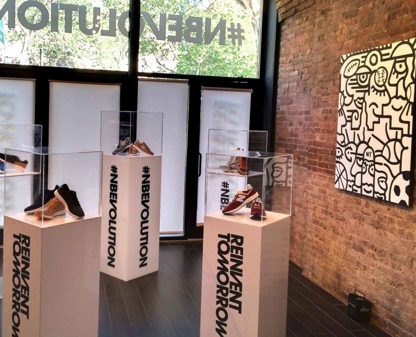 Branded pedestals showcased New Balance's new line of sneakers, allowing guests an in-depth look into the products.