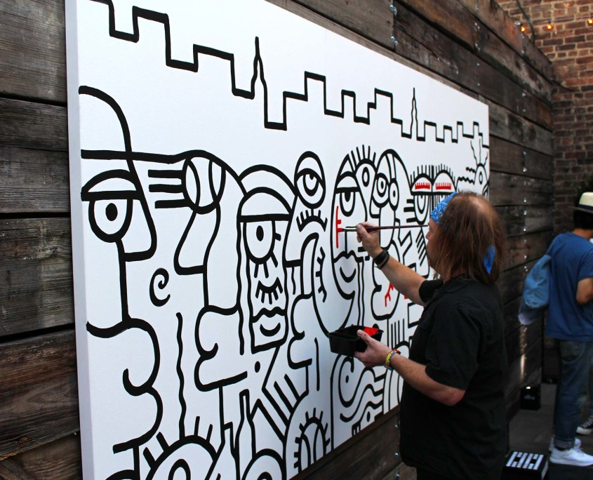 Billy the Artist worked on a painting throughout the New Balance Press Event, entertaining the guests with live art.