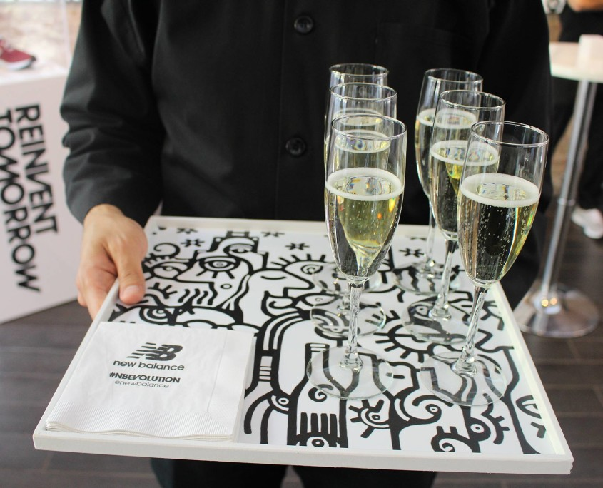 Guests enjoyed drinks and appetizers from trays featuring the work of Billy the Artist, turn the entire press event into an immersive art experience.