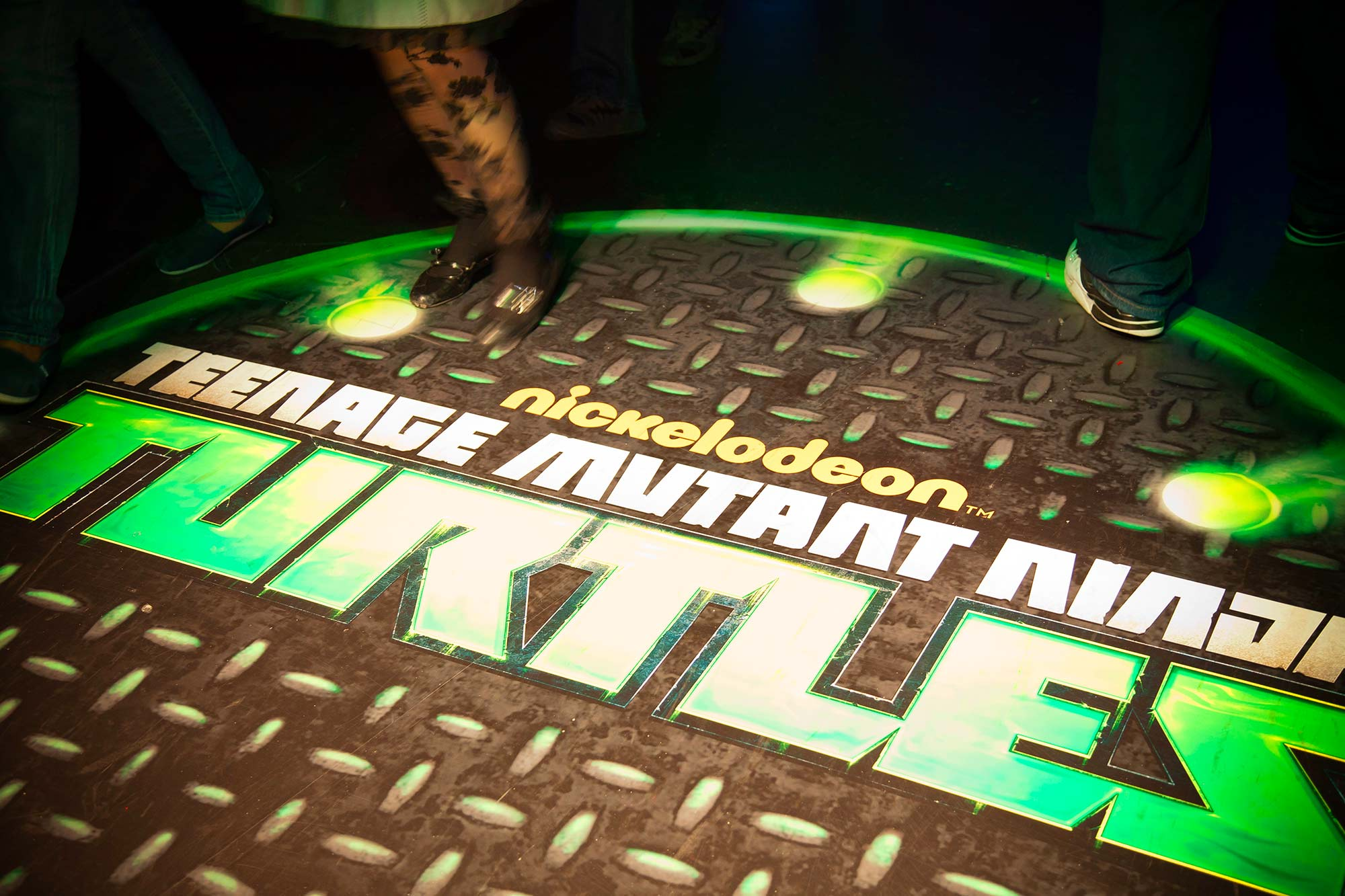 Branded manhole covers greeted guests as they stepped into the immersive experience of Nickelodeon's Teenage Mutant Ninja Turtle hallway.