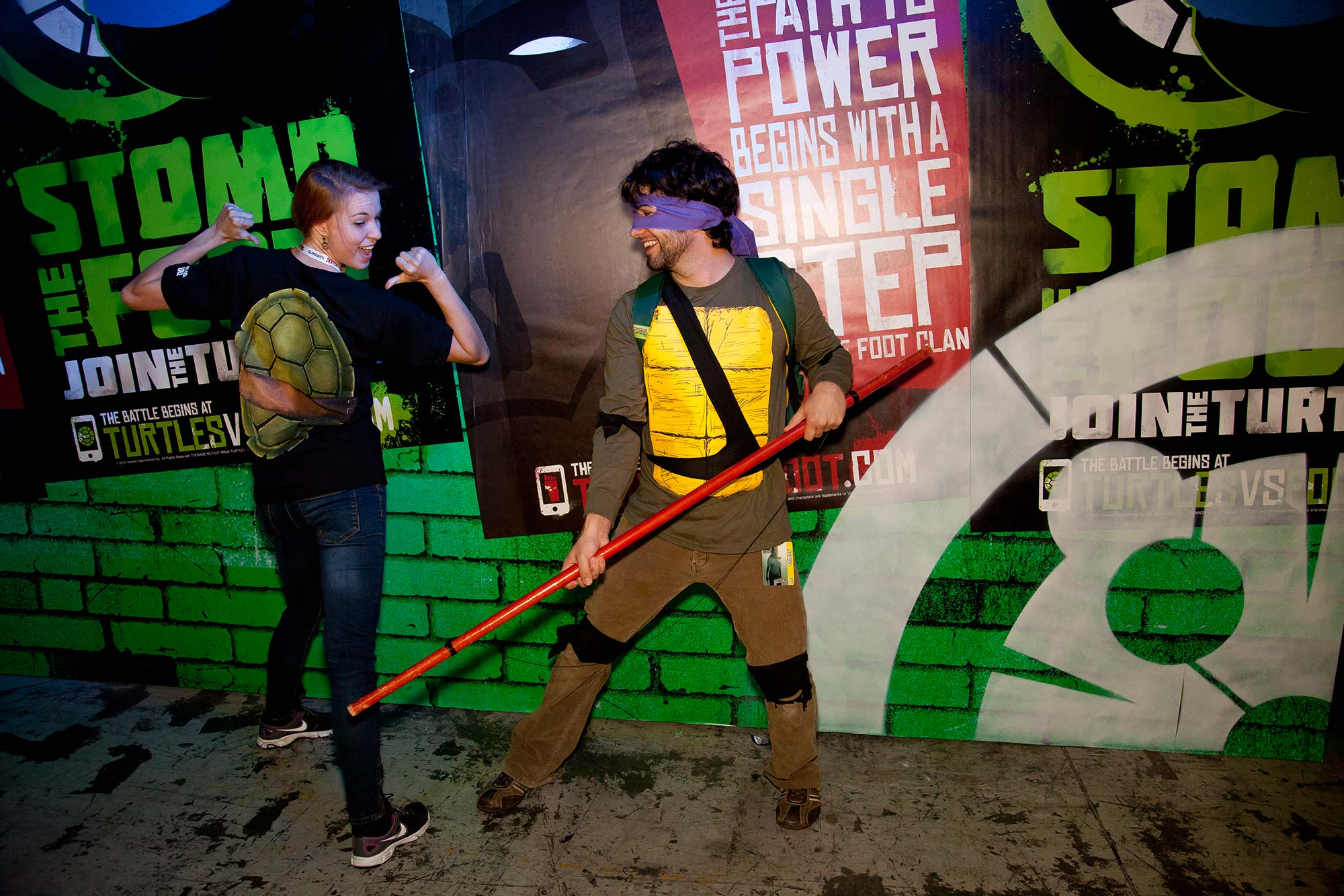Fans pose inside the TMNT lair at New York Comic Con.