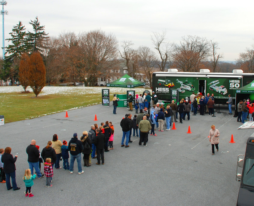 Loyal fans of the Hess brand wait in line for their peek inside the mobile museum at the full collection of the Hess Toy Trucks.