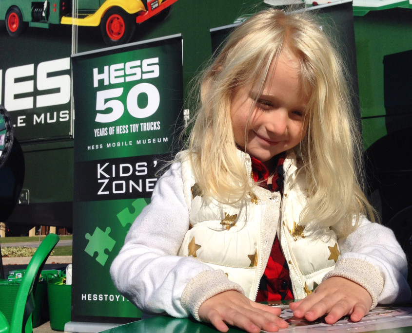 A young girl enjoys the games offered at the Hess Mobile Museum's Kids' Zone.